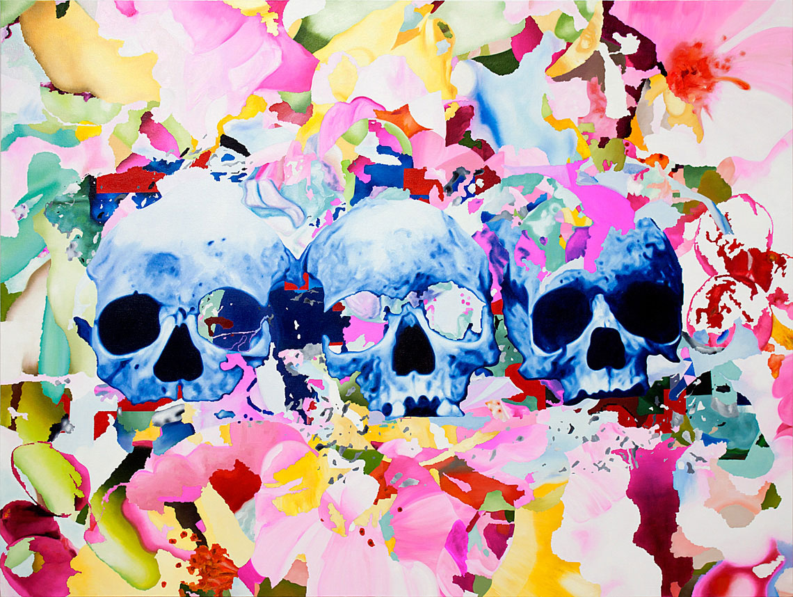 Three colored skulls painted by Roberto López